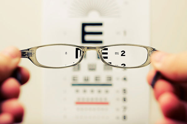 Looking through glasses at a eye test