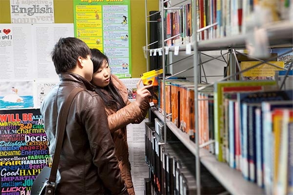 Students looking for books in the library